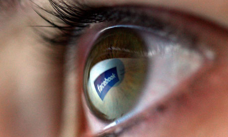 Facebook reflected in the eye of a user